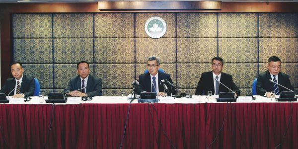 Wong Sio Chak (center) presents the latest security report