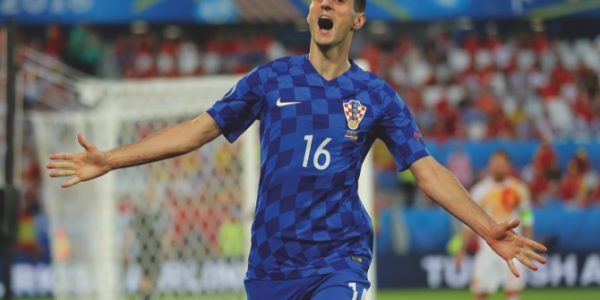 Croatia's Nikola Kalinic celebrates after scoring his side's first goal during the Euro 2016 Group D soccer match against Spain at the Nouveau Stade in Bordeaux