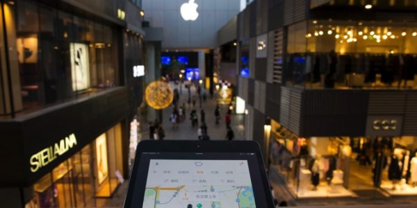 A mobile device shows the Didi Chuxing ride-hailing app at a shopping mall in Beijing