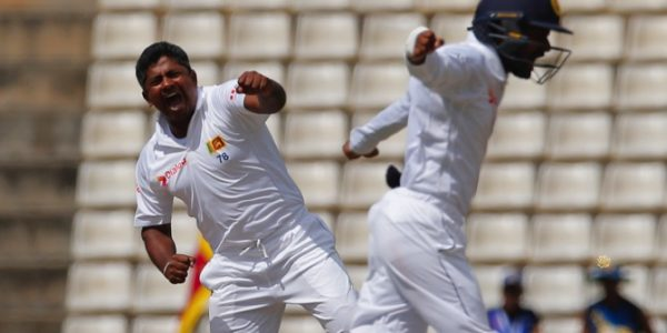 Sri Lanka bowler Rangana Herath (left) celebrates the dismissal of Australia's batsman Usman Khawaja during the second day of the first test cricket match