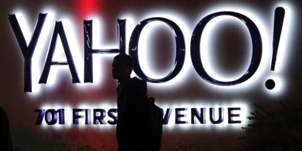 A person walks in front of a Yahoo sign at the company's headquarters in Sunnyvale, Calif.