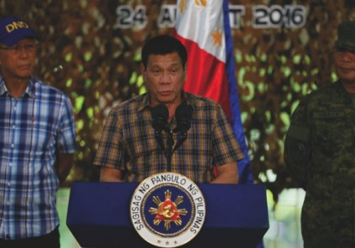 Philippine President Rodrigo Duterte, center, addresses the troops during his visit to the Philippine Army's Camp Mateo Capinpin at Tanay township, Rizal province east of Manila,Philippines Wednesday, Aug. 24, 2016. President Duterte's threat to withdraw the Philippines from the United Nations, later cushioned by his foreign secretary, is the latest flamboyantly irreverent utterance from a politician who has disparaged the pope, human rights advocates, the United States and other countries who controvert his worldview. (AP Photo/Bullit Marquez)