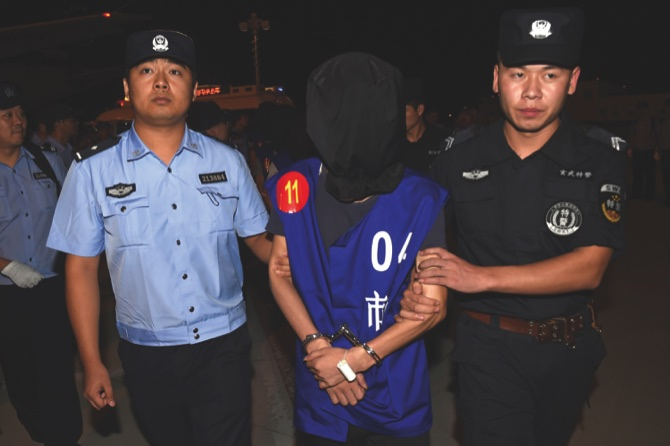 Cambodia deports 63 Chinese, Taiwanese over alleged web scam