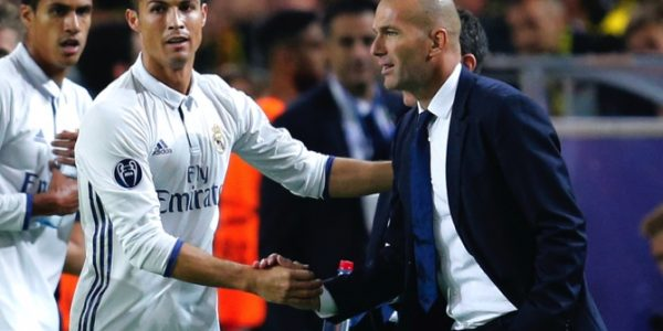 Real Madrid's Cristiano Ronaldo celebrates scoring the opening goal with Real Madrid's head coach Zinedine Zidane during the Champions League group F soccer match