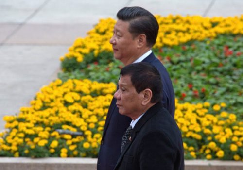 Philippine President Rodrigo Duterte, front  walks near Chinese President Xi Jinping during a welcome ceremony  outside the Great Hall of the People in Beijing