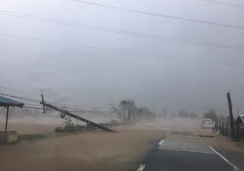 A toppled pole lays along a flooded road as heavy rains and wind from Typhoon Haima batters Narvacan, Ilocos Sur, northern Philippines on Thursday Oct. 20, 2016. Super Typhoon Haima slammed into the northeastern Philippine coast late Wednesday with ferocious winds and rain that rekindled fears and memories from the catastrophe wrought by Typhoon Haiyan in 2013. (AP Photo/Bullit Marquez)