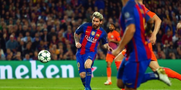 Barcelona's Lionel Messi scores his side's third goal during a Champions League, Group C soccer match between Barcelona and Manchester City