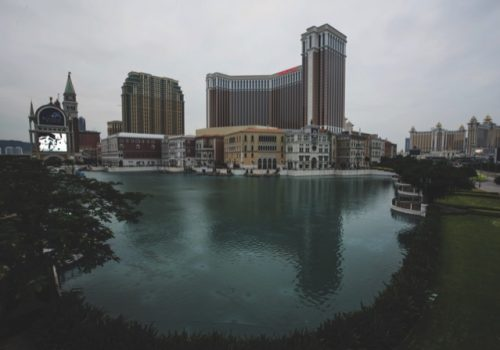 The Venetian Macao resort and casino, operated by Sands China Ltd., a unit of Las Vegas Sands Corp., stands in Macau, China, on Sunday, Dec. 6, 2015. Casino operators in the Chinese gambling hub of Macau saw a 32 percent slump in revenue in November from a year earlier and it's fallen for 18 straight months, data from the city show. Photographer: David Paul Morris/Bloomberg