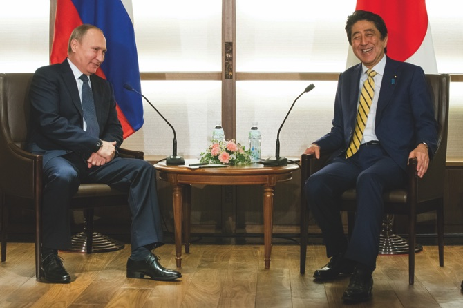 Abe, Putin to huddle at hot spring over Japan-Russia islands row