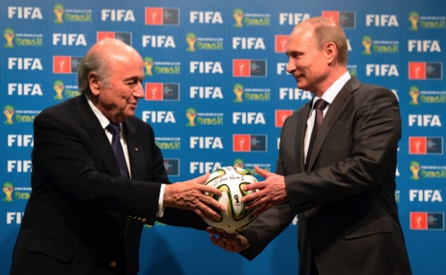 FIFA President Sepp Blatter, left, and Russian President Vladimir Putin hold a soccer ball during the official ceremony of handover to Russia as the 2018 World Cup hosts