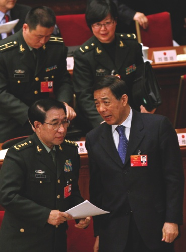 Xu Caihou, bottom left, deputy chairman of the CPC Central Military Commission, which controls China's military, chats with former Chongqing party secretary Bo Xilai, bottom right