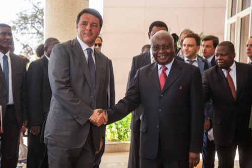 Mozambican President Armando Guebuza (right) shakes hands with the visiting Italian Prime Minister Matteo Renzi (left) in Maputo, Mozambique, on July 19
