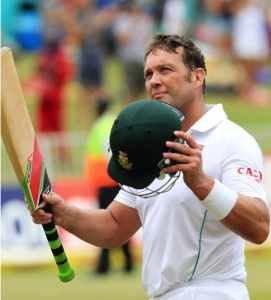South Africa's batsman Jacques Kallis waves his bat as he salutes the fans