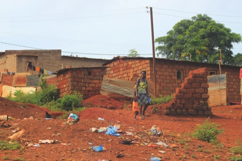 Woman leaving home with her sons in N'dalatando, captital of Angola's Kwanza Norte Province