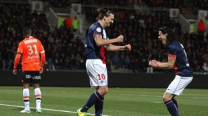 Paris Saint Germain's Zlatan Ibrahimovic, center, and Edison Cavanni, right, jubilate after the first goal during their French League one soccer match, in Lorient