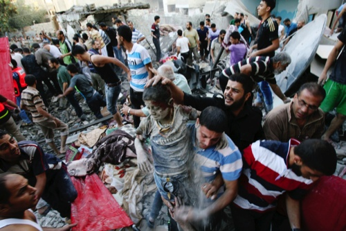 Palestinians evacuate a survivor of an Israeli air strike that hit the Al Ghoul family building in Rafah, southern Gaza Strip