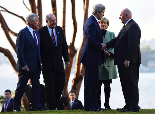 U.S. Secretary of State John Kerry, third from right, along with U.S. Secretary of Defense Chuck Hagel, left, Australian Defense Minister David Johnston, second from left, and Australian Foreign Minister Julie Bishop, is greeted by Governor-General Peter Cosgrove at Admiralty House in Sydney