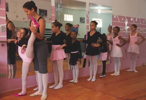 Ballet instructor Joana Machado instructs young girls at her House of Dreams dance studio in Crackland, one of the roughest neighborhoods of downtown Sao Paulo