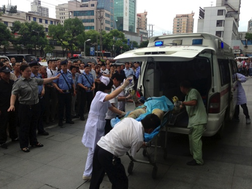 Medical staff move a severely burnt victim of an explosion at an eastern Chinese automotive parts factory from a hospital in the city of Kunshan, Jiangsu Province to a Shanghai hospital