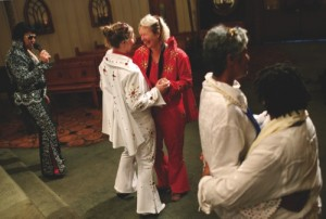 Sari Van Poelje, in red, dances with Katharina during their commitment ceremony given by Elvis tribute artist Michael Conti