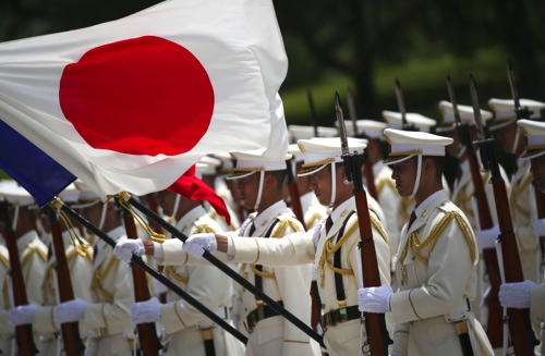 Members of a Japan Self-Defense Forces' honor guard prepare to be inspected by French Defense Minister Jean-Yves Le Drian at the Defense Ministry in Tokyo