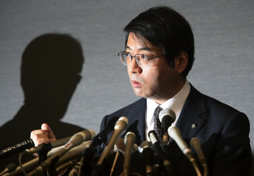 Yoshiki Sasai, deputy chief of the RIKEN Center for Developmental Biology, speaks during a press conference in Tokyo