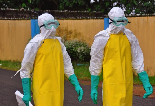 Health workers wearing protective gear
