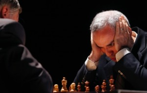 Former chess world champion Garry Kasparov, right, and Anatoly Karpov, left, play an exhibition rematch in Valencia, Spain