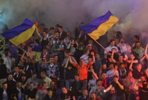 Shakhtar's Donetsk supporters wave Ukrainian flags