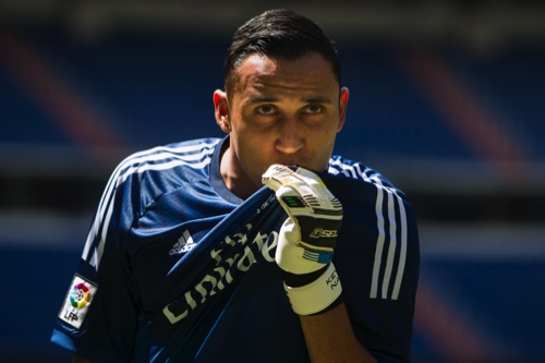 Costa Rica international goalkeeper Keylor Navas, kisses his Real Madrid t-shirt as he poses during his official presentation at the Santiago Bernabeu stadium in Madrid, Spain