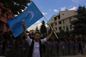 A man waves a Turkistan flag as Uighurs living in Turkey protest the killing of people allegedly killed by Chinese security in China's far-western Xinjiang Uighur Autonomous Region five years ago, outside the Chinese embassy in Ankara