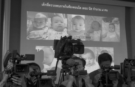 Thai police display pictures of surrogate babies born to a Japanese man who is at the center of a surrogacy scandal during a press conference at the police headquarters in Chonburi, Thailand