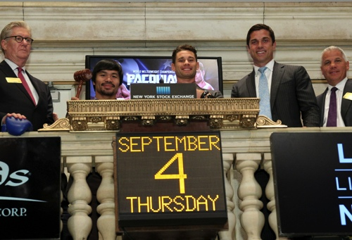 Pacquiao and Algieri (seen accompanied by Sands China CEO Edward Tracy) ring the Closing Bell at the New York Stock Exchange