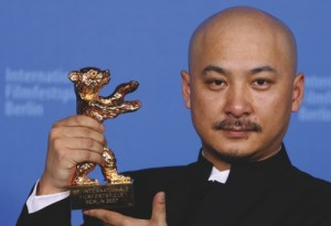 "In this Feb. 17, 2007 file photo, Chinese film director Wang Quan'an shows his Golden Bear award for the best movie at the 57th International Film Festival Berlin 'Berlinale' in Berlin for his movie ""Tuya's Marriage."""