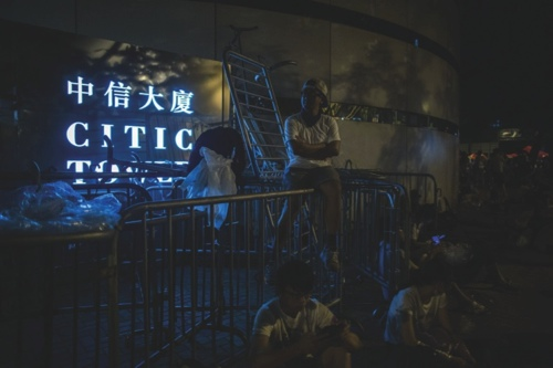 Demonstrators use barricades to block the entrance of the Citic Tower during a protest in Hong Kong