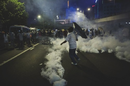Demonstrators disperse as tear gas is fired in Hong Kong