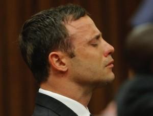 Oscar Pistorius reacts in the dock in Pretoria, South Africa