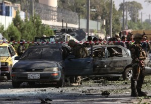 NATO and Afghan security forces inspect the site of a suicide attack in Kabul