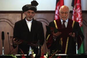 Afghan President Ashraf Ghani Ahmadzai, left, is sworn in by Chief Justice Abdul Salam Azimi, during his inauguration ceremony at the presidential palace in Kabul
