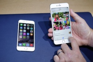 The iPhone 6, left, and iPhone 6 plus are shown next to each other