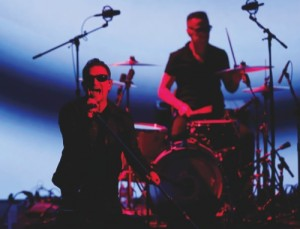 U2 members Bono, left, and Larry Mullen Jr. perform during an announcement of new products by Apple this week