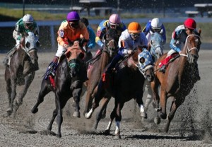 Horses take a turn during a race at Suffolk Downs in Boston
