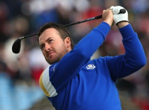 Europe's Graeme McDowell plays a shot off the 3rd tee during the singles match on the final day of the Ryder Cup golf tournament, at Gleneagles