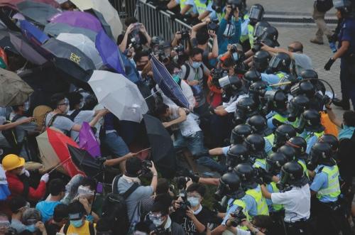 Riot police use pepper spray against demonstrators