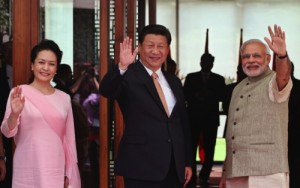 Indian Prime Minister Narendra Modi, right, Chinese President Xi Jinping and Xi's wife Peng Liyuan, left wave to the media after Modi received them upon arrival in Ahmadabad