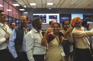 Indian Space Research Organisation scientists and officials cheer as they celebrate the success of Mars Orbiter Mission at their Telemetry, Tracking and Command Network complex in Bangalore