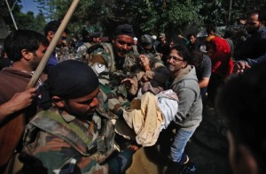 Indian army soldiers and civilians rescue an elderly flood victim in Srinagar, in Indian-controlled Kashmir