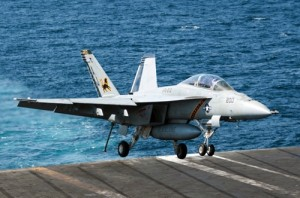 An F/A-18F Super Hornet attached to the Fighting Black Lions of Strike Fighter Squadron lands aboard the aircraft carrier USS George H.W. Bush in the Persian Gulf