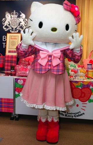 Hello Kitty poses in its original tartan blouse and ribbon