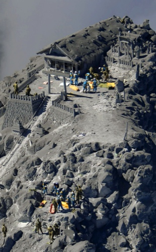An aerial view shows rescue workers searching for missing people on erupted Mount Ontake, central Japan